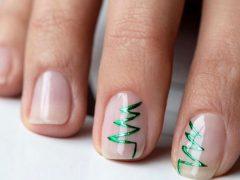Новогодний дизайн ногтей. Фото: instagram.com/bebebe.msc
