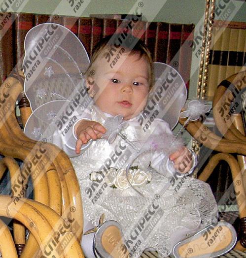 Машенька, годовалая дочь Сергея, - копия папы